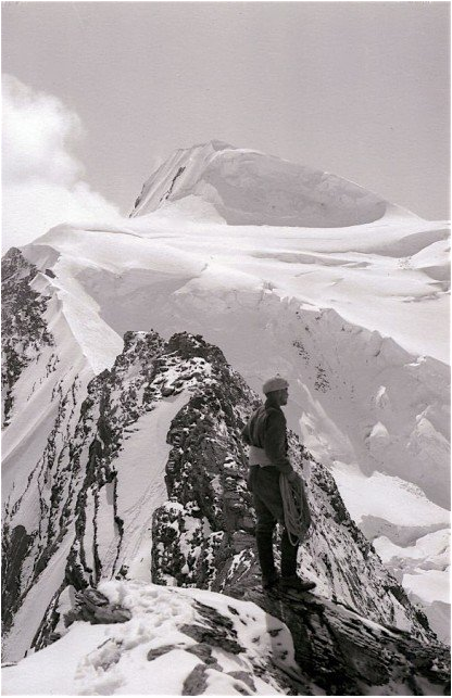 Conrad Kain on gendarme of Mount Resplendent, Robson ACC Camp. 1913. Byron Harmon photo V263 / 950. Whyte Museum of the Canadian Rockies.